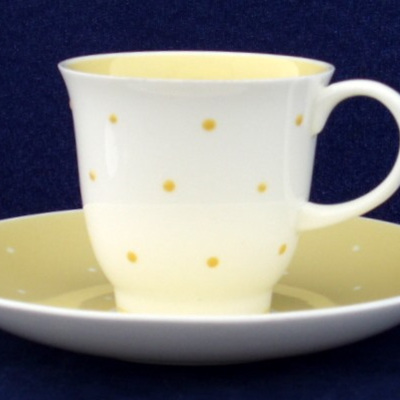 Yellow spots on Susie Cooper coffee cup and saucer